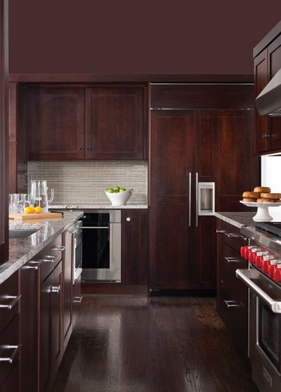 Dark cherry panels clad the refrigerator in the kitchen for a clean, uncluttered look.