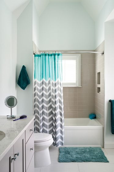 A kids' bath is enlivened with playful punches of aqua.