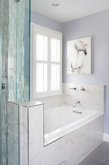 A soaking tub beckons in the master bath.