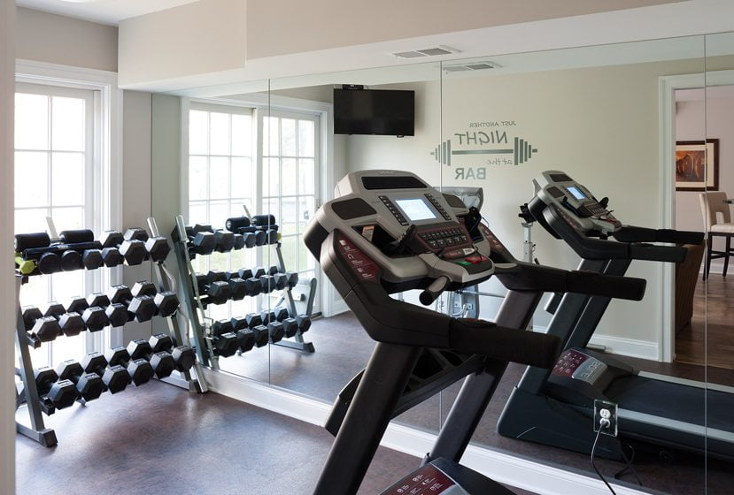 A fully equipped gym occupies the lower level.
