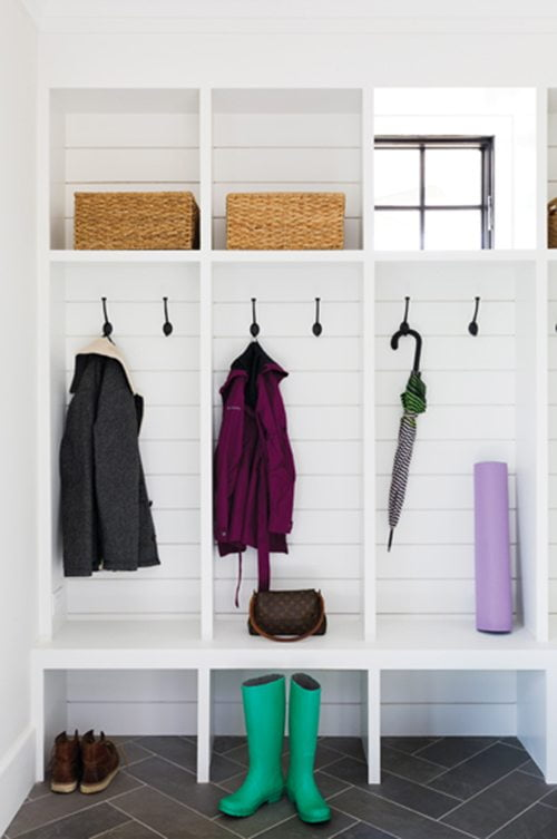 Shiplap siding adds interest in the spacious mudroom.