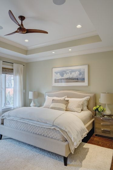 The main-floor master bedroom boasts a coffered ceiling and furniture from Willem Smith.