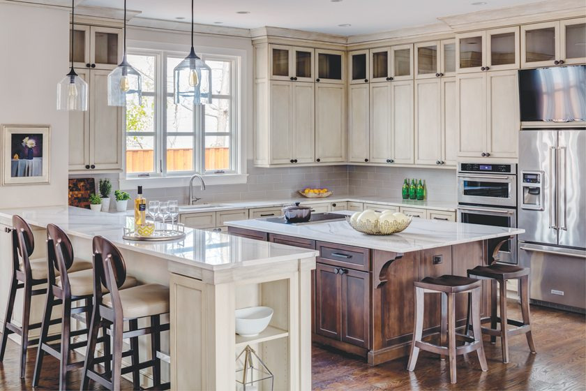 The kitchen boasts two-tone, custom-maple cabinetry and quartz countertops.