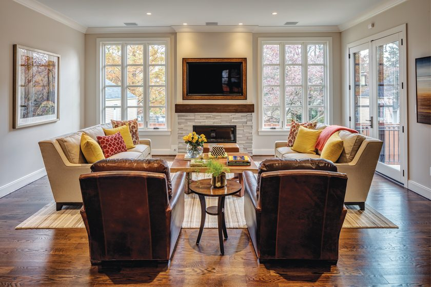 A ledger-stone fireplace anchors the sitting area.