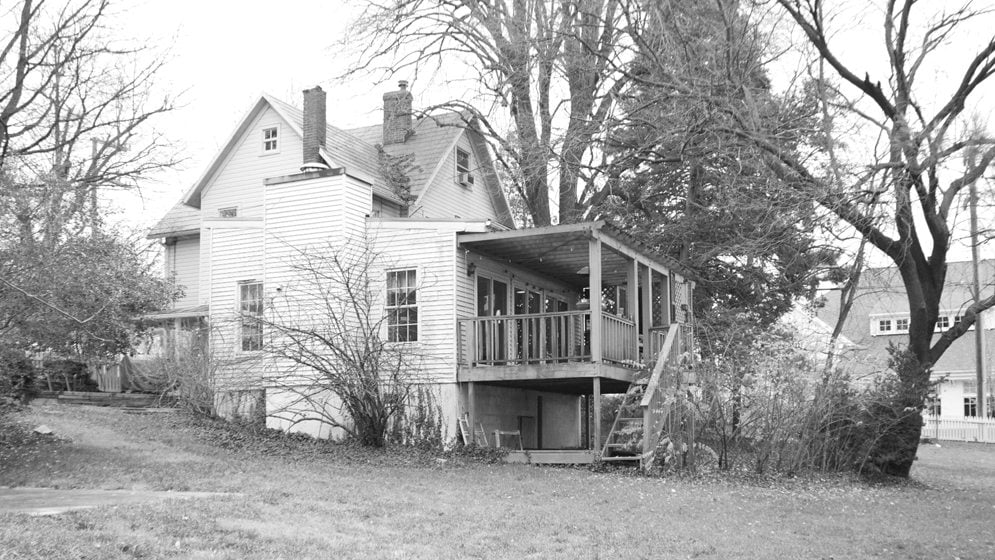 BEFORE: A rickety back porch was replaced with the sprawling rear addition.
