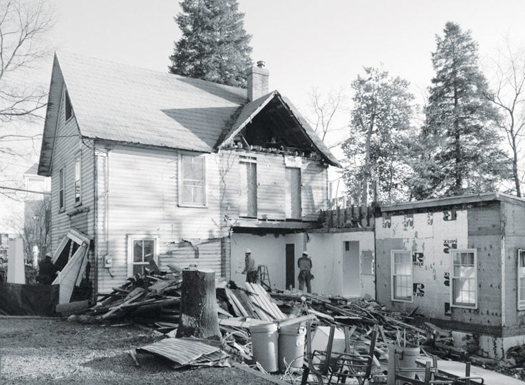 BEFORE: An addition was demolished to make way for a bigger one that honors the home's architecture.