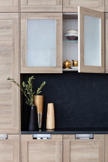 A detail of the farmhouse kitchen cabinetry. © Jennifer Hughes