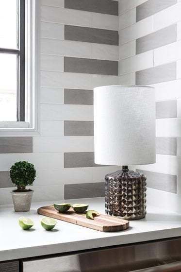 Matte cement tile from Architectural Ceramics forms an unusual backsplash pattern.