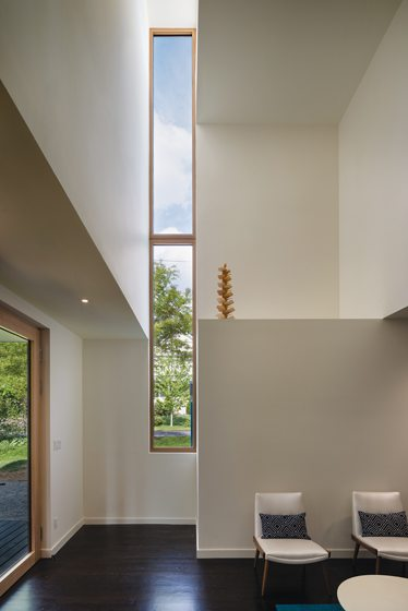 A sliver window brings light into the playroom.