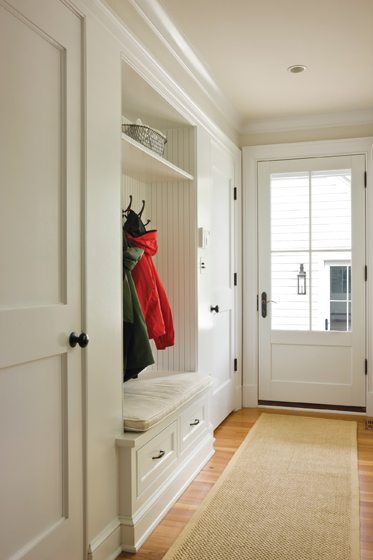 A breezeway connects the remodeled garage with a mudroom.