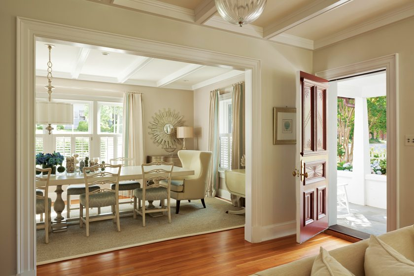 The former front door opens into the original wing, now remodeled and unified with the addition by ceiling coffers.
