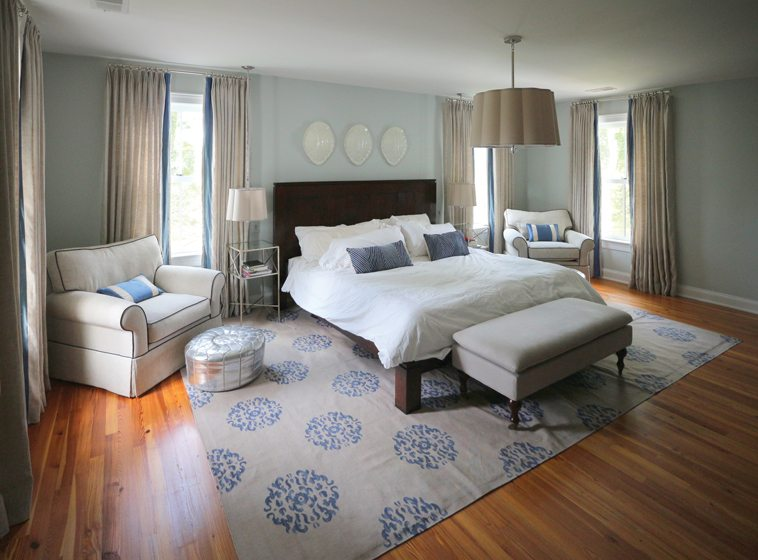 The spacious master bedroom is a restful retreat in blue and beige.