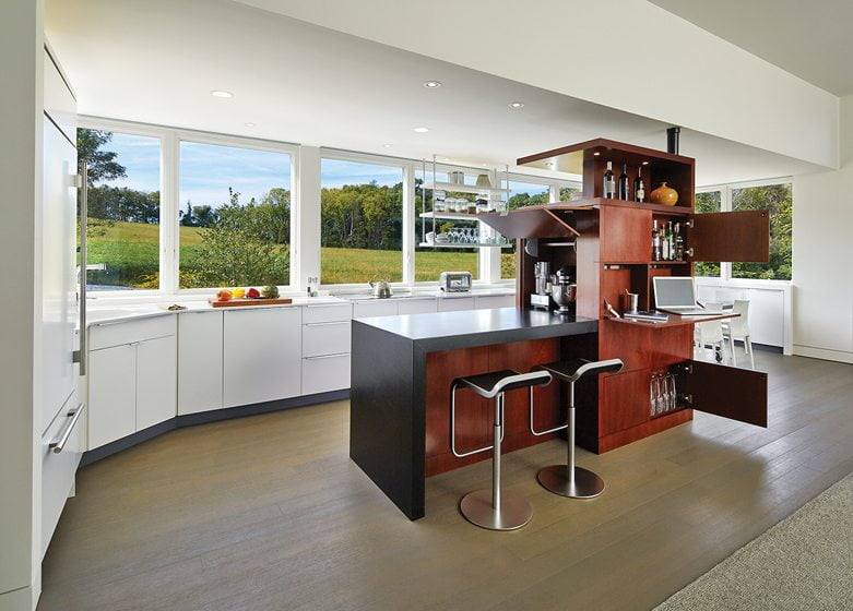 The custom unit conceals small appliances, a desk and a liquor cabinet. © Anice Hoachlander