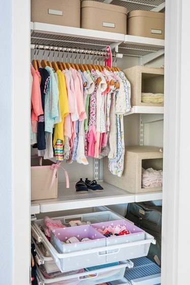 The elfa system's hanging drawers store small items in easy reach.