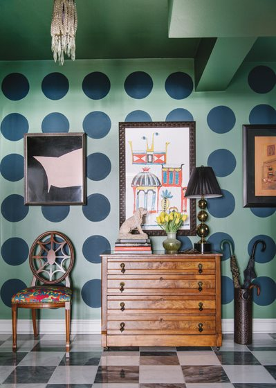 Color and pattern enliven the foyer, where green walls are adorned with navy polka dots by decorative painter Steven Hammel.