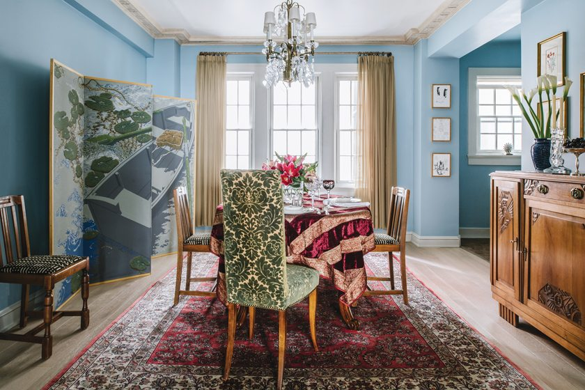Vintage Kuba cloth covers the dining chairs while the high-backed host chairs are upholstered in cut-velvet damask.