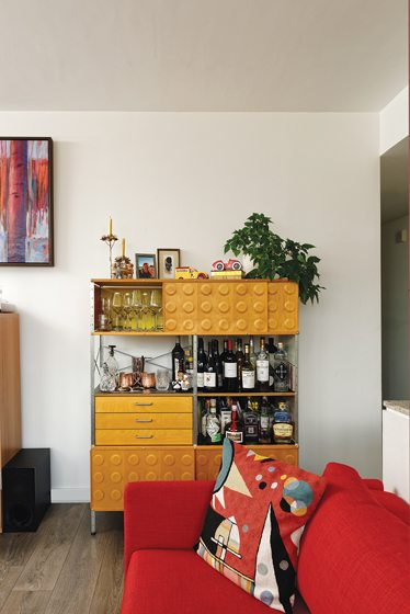 A Design Within Reach storage unit doubles as a stocked liquor cabinet.