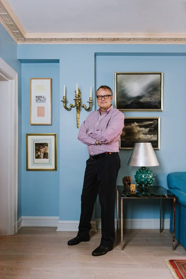 Designer Charles Krewson poses among collected artworks.