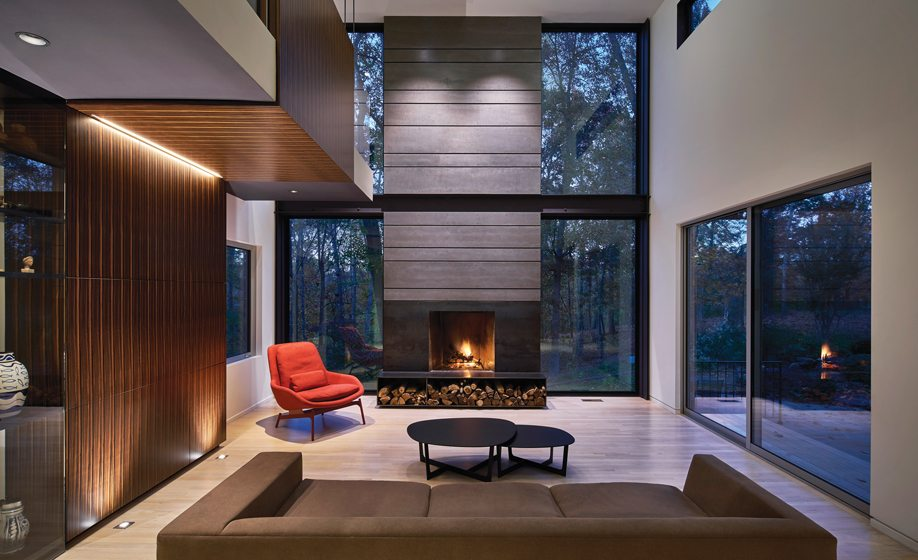 In the family room, windows flank the fiber-cement-paneled fireplace.