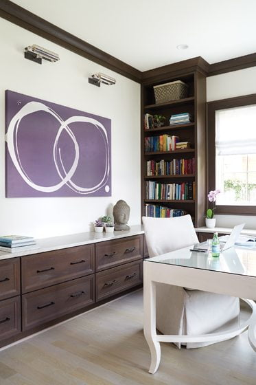 A bold abstract canvas by Kayce Hughes in the home office is a focal point.