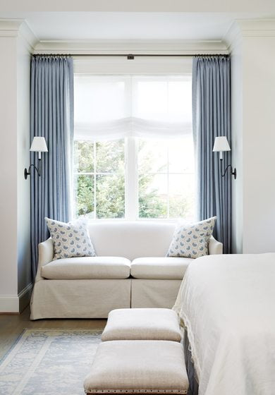 A loveseat by Lee Industries fills a niche in front of the window.