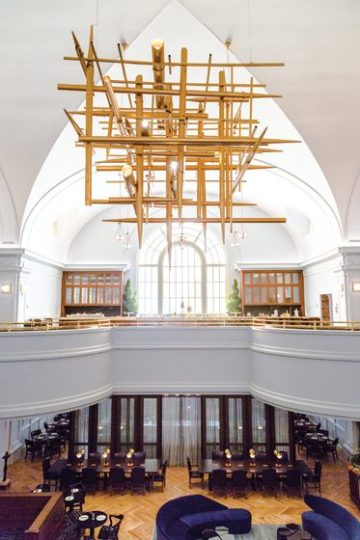 Original brass organ pipes were repurposed to create an awe-inspiring lobby chandelier. Photo by Gary Williams