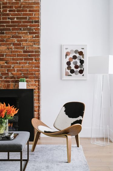A Hans Wegner Shell chair sits beside the vent-free gas fireplace.