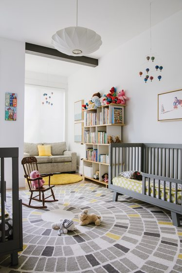 The couple's twins share a cozy room with matching toddler beds.