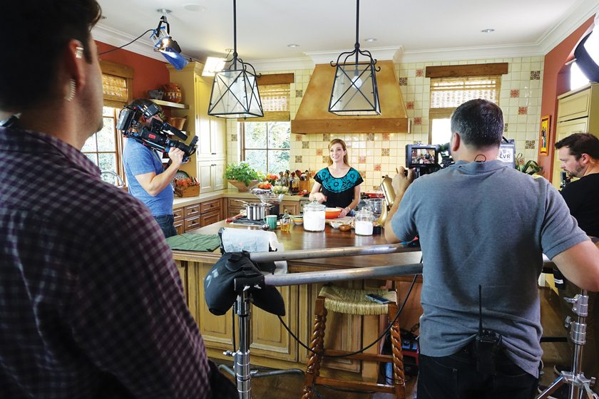 "In the kitchen, Jinich and crew film an episode of ""Pati's Mexican Table."""