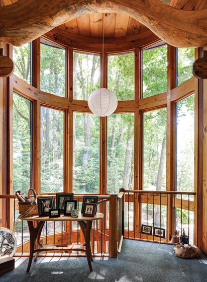 A glass tower in Von Voss's house brings the outdoors in. Photo by Bruce Buck