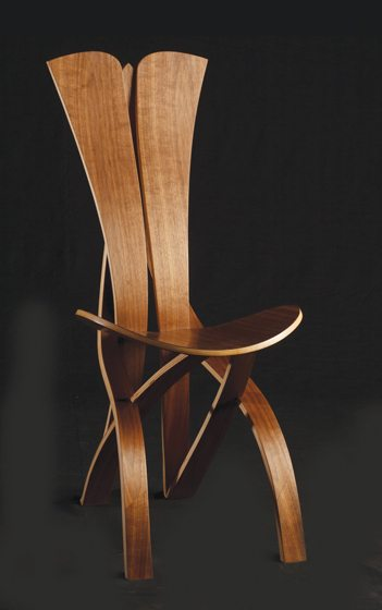 Slabs of wood become sculptural pieces such as his signature chair.