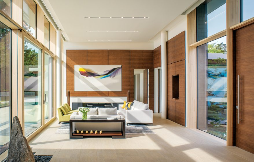 Dramatic artwork anchors the gallery's sitting area, paneled in black walnut.
