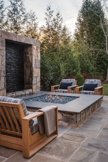 The fire pit and fountain are a custom design by Monarch Homes.