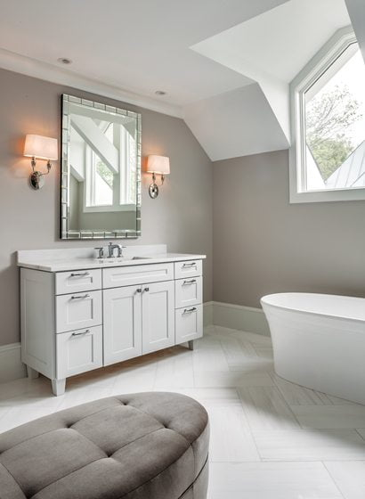 Heated marble floors enhance the master bathroom's spa-like feel.