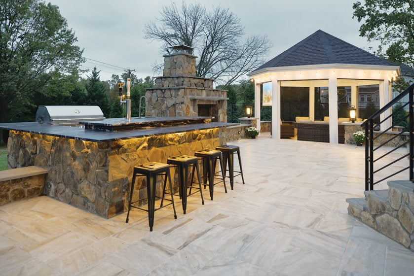The renovated deck features a gazebo and a granite-topped bar.