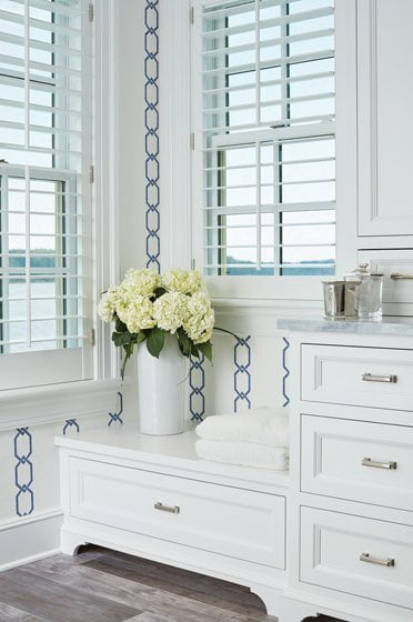 Custom cabinetry frames water views.