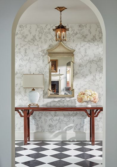 The foyer features Chinoiserie wallpaper by Brunschwig & Fils.