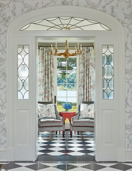 Leaded-glass sidelites enclose the door to the sunroom off the main entry foyer.