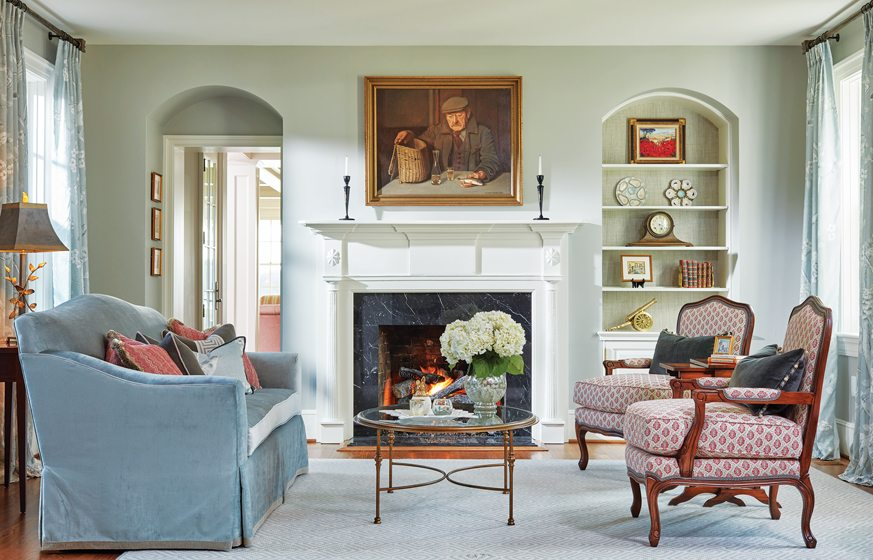 In the existing living room, a Charles Stewart sofa is combined with Drexel Heritage bergères.