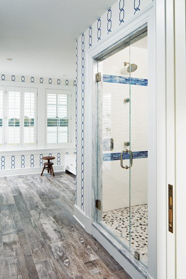 The master bath boasts wood-look porcelain floors from Compass Tile.