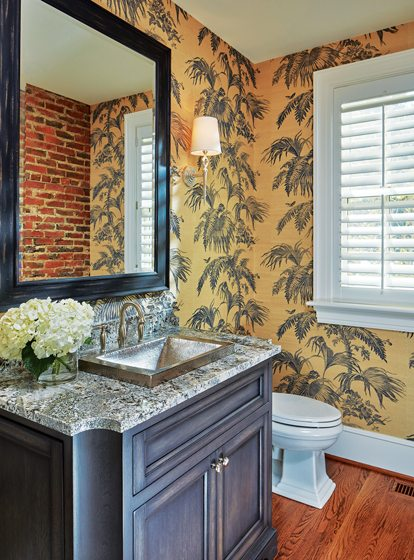 Wallpaper by Stroheim & Romann embellishes a powder room in the new wing.
