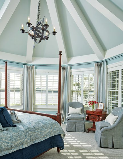 A serene blue palette evokes a coastal feel in the master bedroom housed in the new octagonal structure.