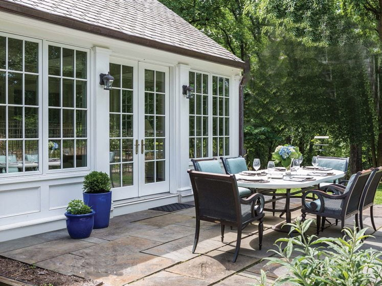 The sunroom opens onto a patio with space for al fresco dining.