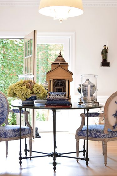 In the dining room, cerused-oak floors are a backdrop for furnishings and antiques.