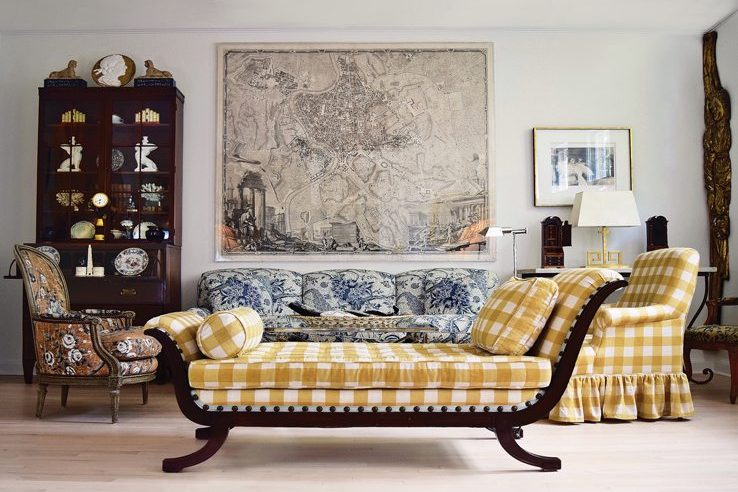 An 18th-century map of Rome anchors seating in the living room.