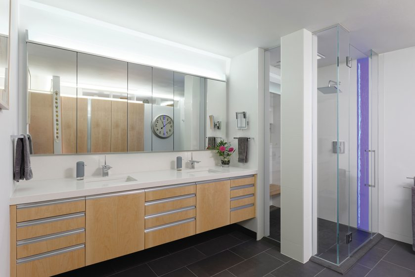 The contemporary master bath boasts heated porcelain-tile floors.
