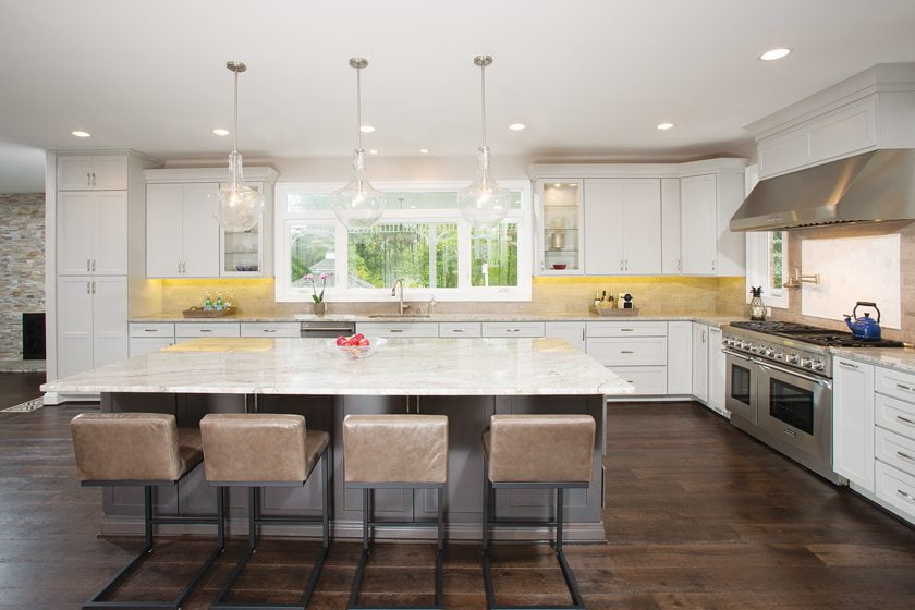 The 22-foot island features glass-fronted shelving and plenty of storage behind closed doors.