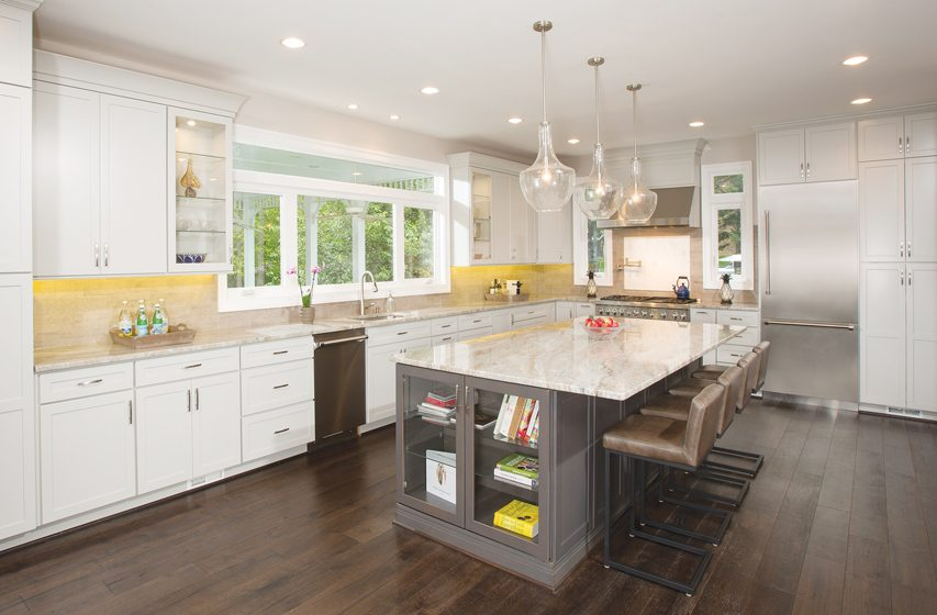 The renovated kitchen is light and airy with a 10-foot span of windows above the sink.
