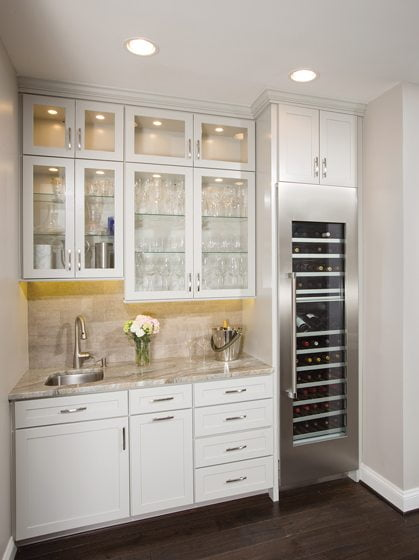 The kitchen contains a butler's pantry with a beverage center.