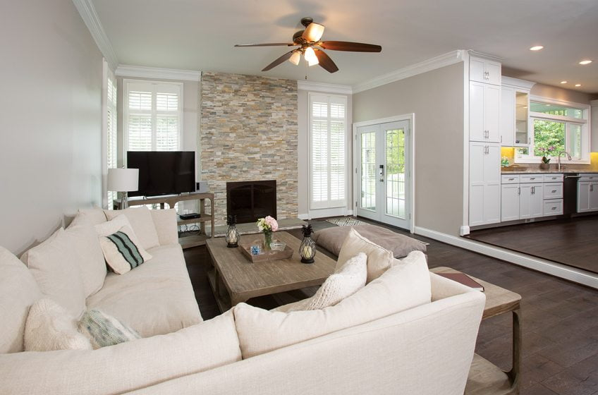 In the family room, a ledger-stone fireplace replaced the original wood one.